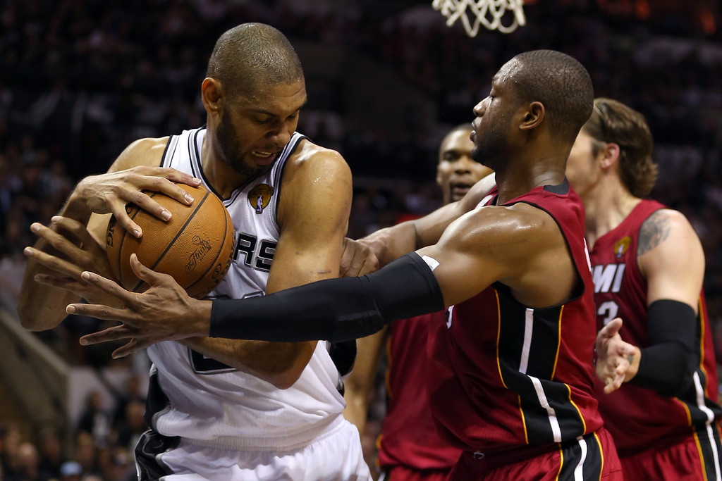 . Tim Duncan #21 of the San Antonio Spurs with the ball against Dwyane Wade #3 of the Miami Heat in the second quarter during Game Three of the 2013 NBA Finals at the AT&T Center on June 11, 2013 in San Antonio, Texas.   (Photo by Mike Ehrmann/Getty Images)