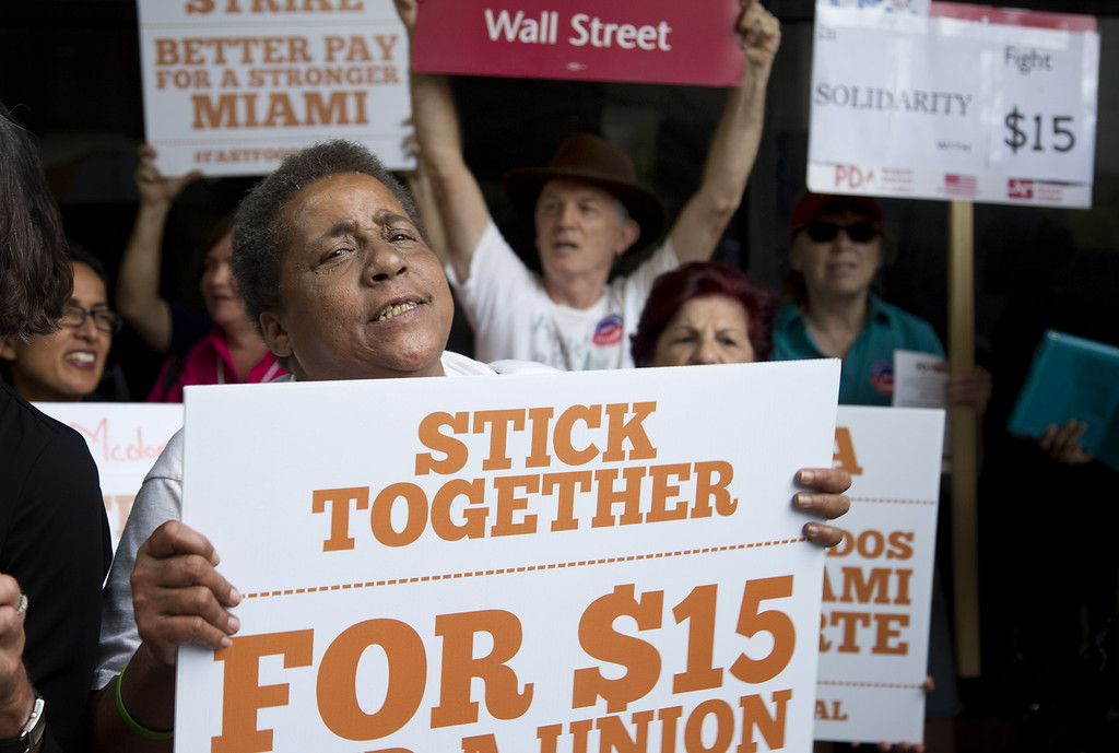 . Hattie Coleman sings protest chants during a rally for fast food workers in Miami, Thursday, May 15, 2014. (AP Photo/J Pat Carter)