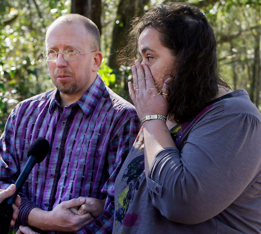 . Aaron Poland and Lydia Hancock, son and daughter of murdered bus driver Charles Poland, react as they talk about him during an interview at their father\'s home in Newton, Alabama, January 31, 2013. Poland died January 29 at the scene of a shooting and hostage taking in nearby Midland City. The standoff stretched into a third day on Thursday with an Alabama man accused of fatally shooting a school bus driver and then taking a young boy hostage in an underground bunker equipped with electricity and food. REUTERS/Phil Sears