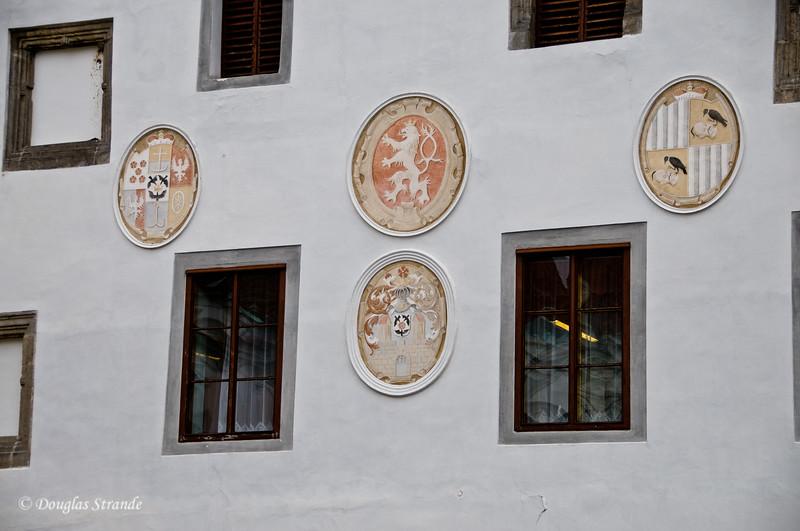Cesky Krumlov building displays crests