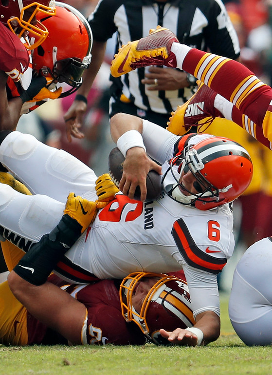. Washington Redskins defensive end Trent Murphy, bottom, sacks Cleveland Browns quarterback Cody Kessler (6) during the first half of an NFL football game, Sunday, Oct. 2, 2016, in Landover, Md. (AP Photo/Carolyn Kaster)