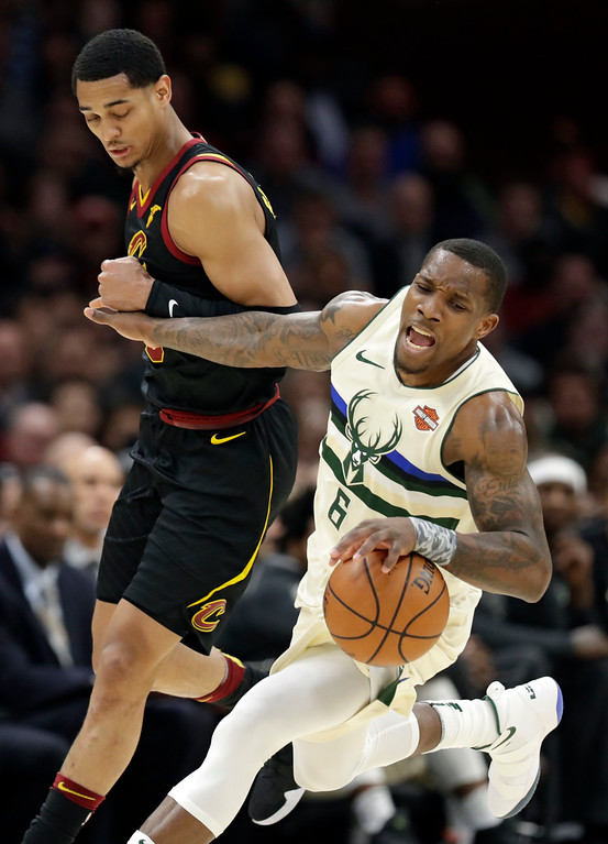 . Cleveland Cavaliers\' Jordan Clarkson, left, fouls Milwaukee Bucks\' Eric Bledsoe in the second half of an NBA basketball game, Monday, March 19, 2018, in Cleveland. (AP Photo/Tony Dejak)