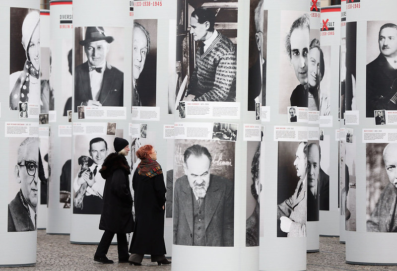 ". Visitors walk among portraits of Berlin Jews and political opponents persecuted, and in many cases murdered or driven to suicide, by the Nazis in the exhibition ""Diversity Destroyed\"" on January 30, 2013 in Berlin, Germany. The exhibition coincides with the 80th anniversary of the assumption of power by the Nazis with the appointment of Adolf Hitler as Reichskanzler, or Chancellor of the Empire.  (Photo by Sean Gallup/Getty Images)"
