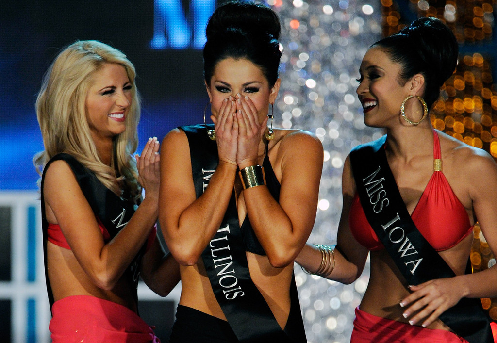 . Laura McKeeman (L), Miss Florida, and Mariah Cary (R), Miss Iowa, congradulate Megan Ervin, Miss Illinois, as she reacts during the 2013 Miss America Pageant at PH Live at Planet Hollywood Resort & Casino on January 12, 2013 in Las Vegas, Nevada.  (Photo by David Becker/Getty Images)