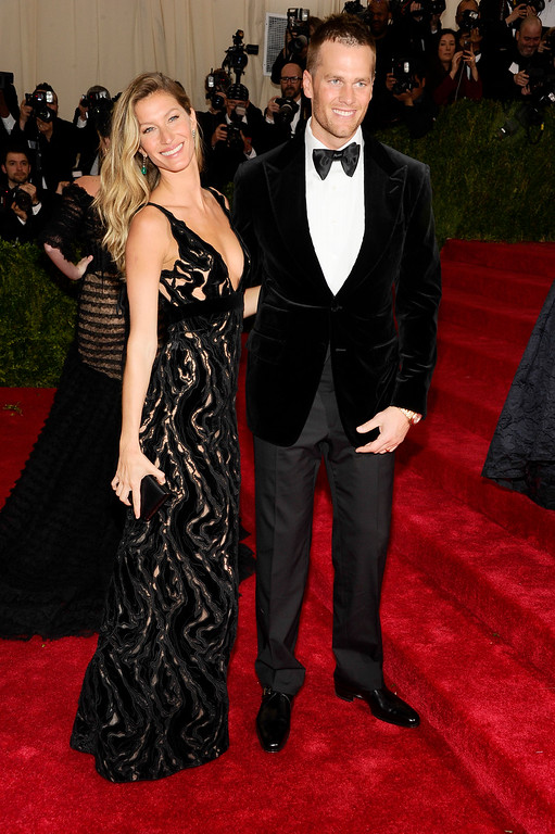 """. Gisele Bundchen, left, and Tom Brady attend The Metropolitan Museum of Art\'s Costume Institute benefit gala celebrating \""""Charles James: Beyond Fashion\"""" on Monday, May 5, 2014, in New York. (Photo by Charles Sykes/Invision/AP)"""