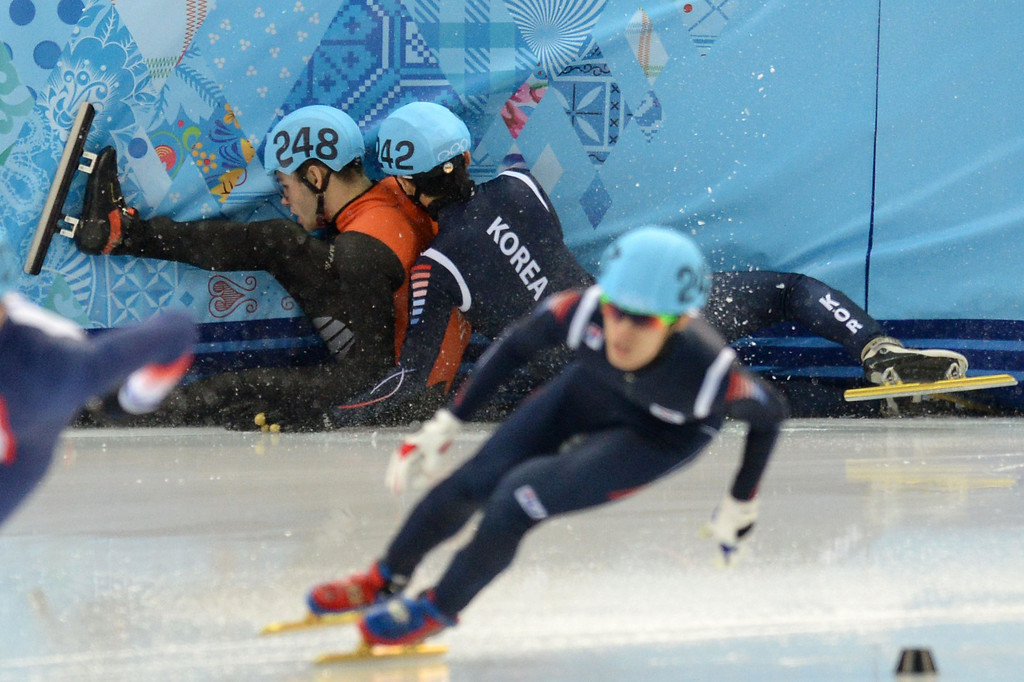 . Netherlands\' Sjinkie Knegt (L) and South Korea\'s Park Se Yeong (back R) fall as they compete in the Men\'s Short Track 1500 m Final B at the Iceberg Skating Palace during the Sochi Winter Olympics on February 10, 2014.  AFP PHOTO / YURI  KADOBNOV/AFP/Getty Images
