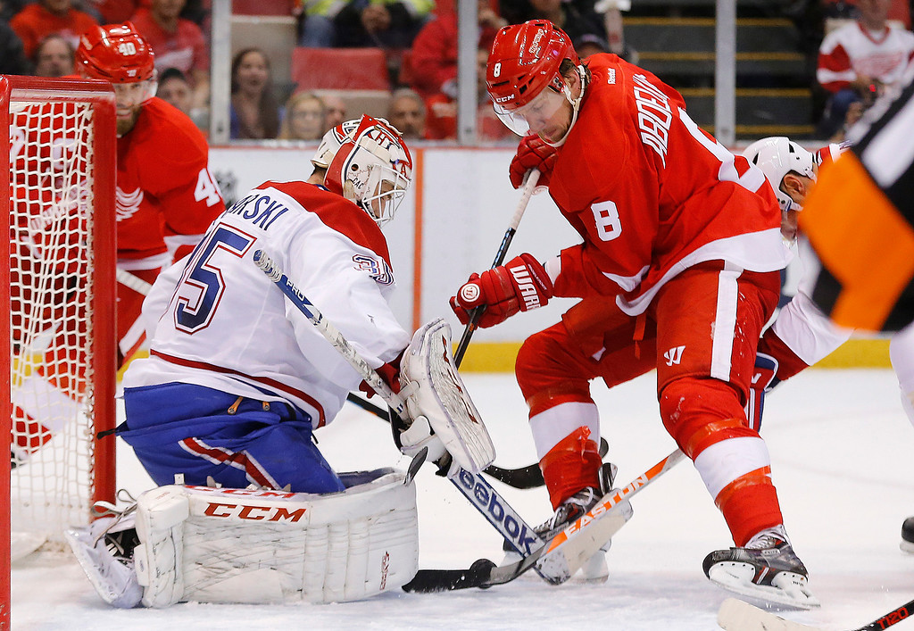 . Montreal Canadiens goalie Dustin Tokarski (35) stops a Detroit Red Wings left wing Justin Abdelkader (8) shot in the first period of an NHL hockey game in Detroit, Sunday, Nov. 16, 2014. (AP Photo/Paul Sancya)