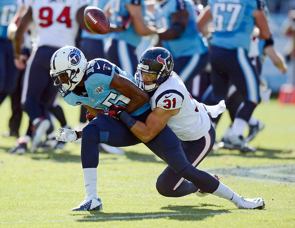 . Houston Texans free safety Shiloh Keo (31) breaks up a pass intended for Tennessee Titans wide receiver Justin Hunter (15) in the first quarter of an NFL football game Sunday, Dec. 29, 2013, in Nashville, Tenn. (AP Photo/Mark Zaleski)