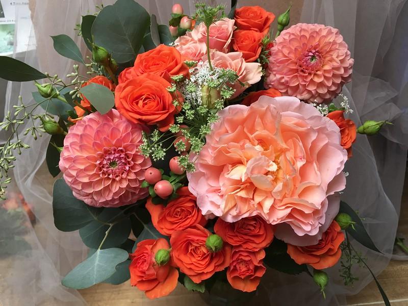 peach dahlias, queen anne's lace orange spray roses, peach else roses  garden peachy - pink rose seeded eucalyptus, beans   $140