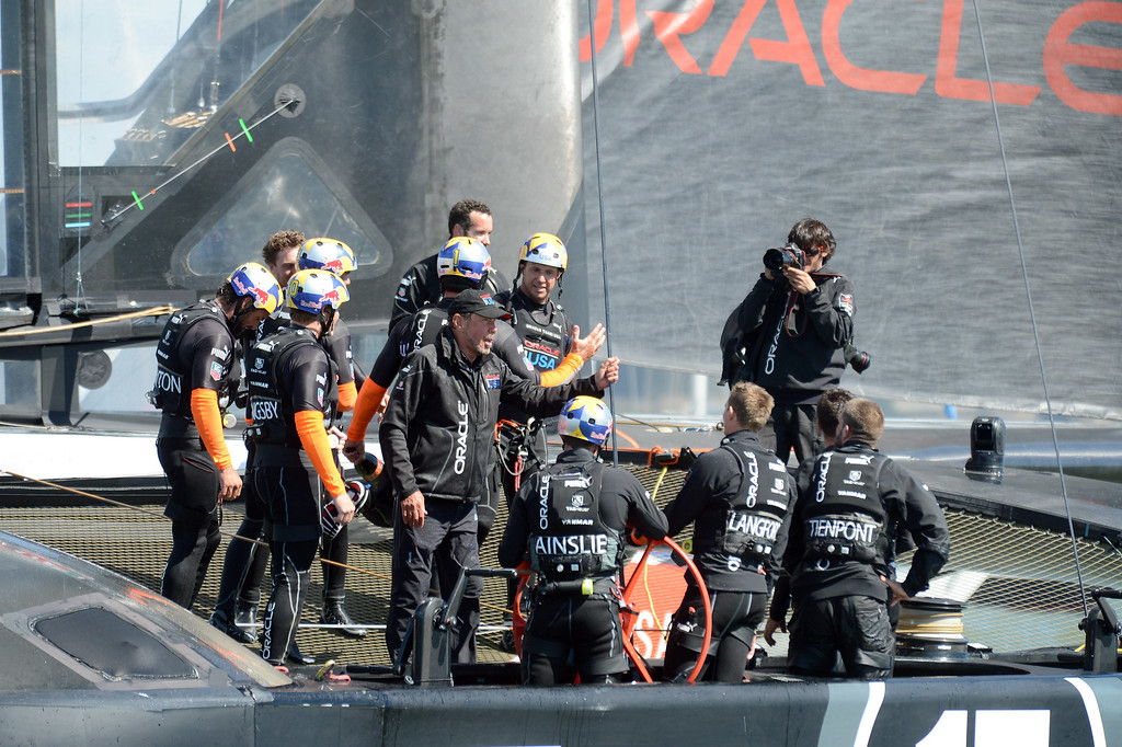 . Larry Ellison rides onboard the Oracle Team USA catamaran following their victory over Emirates Team New Zealand in the 34th America\'s Cup held in San Francisco, Calif., on Wednesday, Sept. 25, 2013. Oracle Team USA came back from down 8-1 to win the Cup 9-8. (Dan Honda/Bay Area News Group)