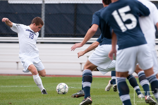 Nov 13, 2011; Ann Arbor, MI, USA; Northwestern Wildcats midfielder Kyle Schickel (19) shoots during the first half against the Penn State Nittany Lions  at the final game of the 2011 Big Ten Championship at Michigan Soccer Stadium. Mandatory Credit: Tim Fuller-US PRESSWIRE
