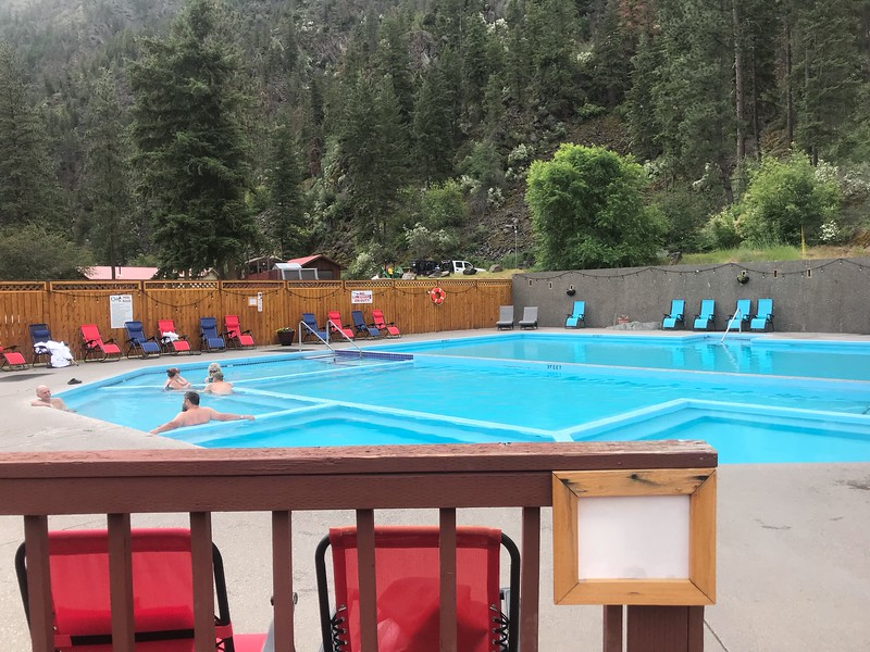 people sitting in a large swimming pool