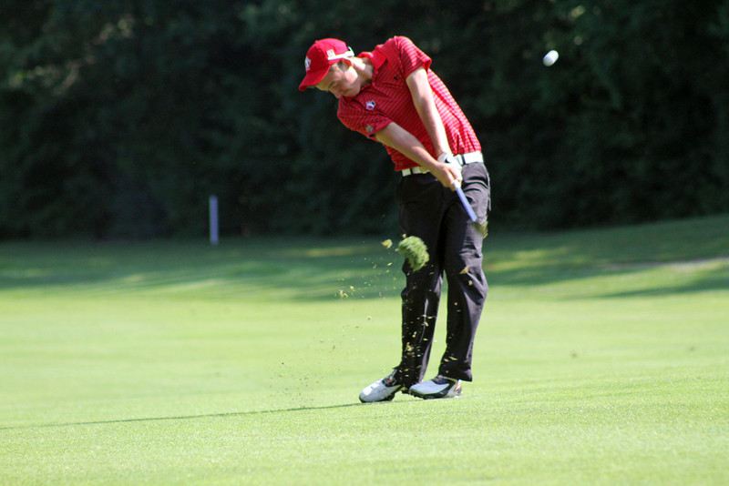After a monstrous drive on the 8th hole, Matthew Scobie of Ajax, Ontario sends a wedge towards the putting surface during the second round of the 96th Western Junior. (WGA Photo/Ian Yelton)