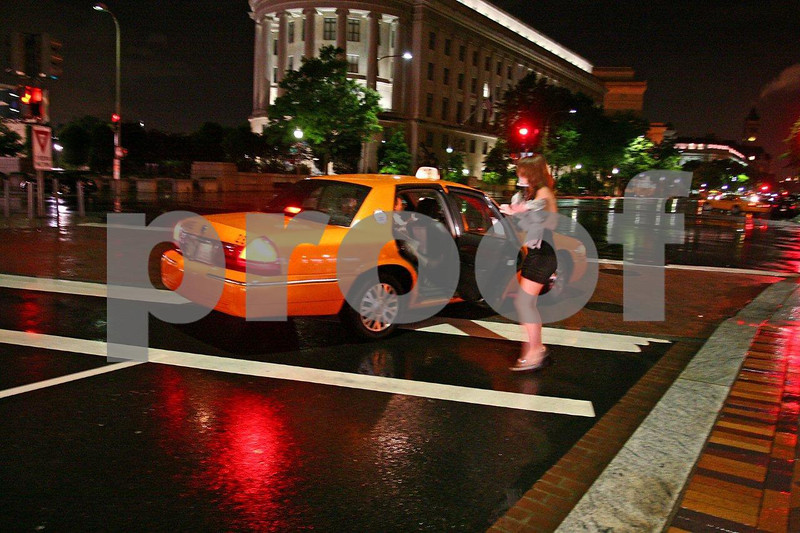 A taxi on a riany night in WA DC.