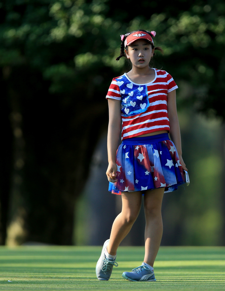. Lucy Li of the USA who is only 11years follows her tee shot at the par 3, 15th hole during the first round of the 69th U.S. Women\'s Open at Pinehurst Resort & Country Club, Course No. 2  on June 19, 2014 in Pinehurst, North Carolina.  (Photo by David Cannon/Getty Images)