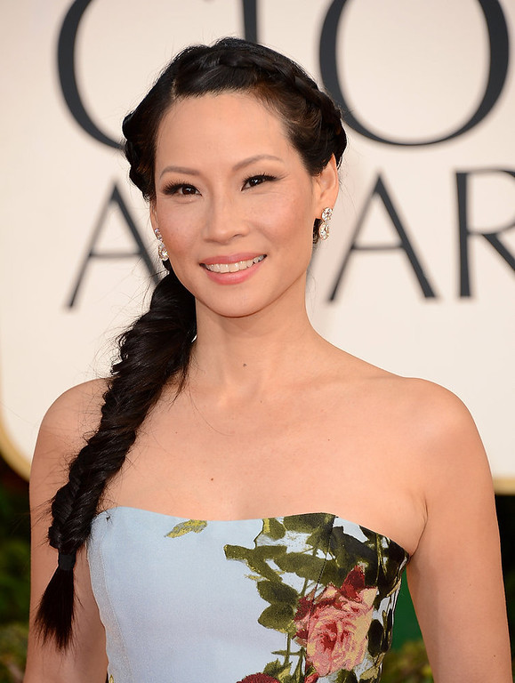 . Actress Lucy Liu hit a home run with her hair and make-up, but her overall look makes her the worst dressed at the 70th Annual Golden Globe Awards.  Though we applaud her for going with such a bold look.  (Photo by Jason Merritt/Getty Images)