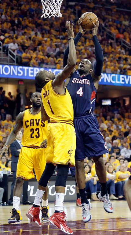 . Atlanta Hawks\' Paul Millsap (4) shoots against Cleveland Cavaliers\' James Jones (1) during the first half in Game 3 of the Eastern Conference finals of the NBA basketball playoffs Sunday, May 24, 2015, in Cleveland. (AP Photo/Tony Dejak)