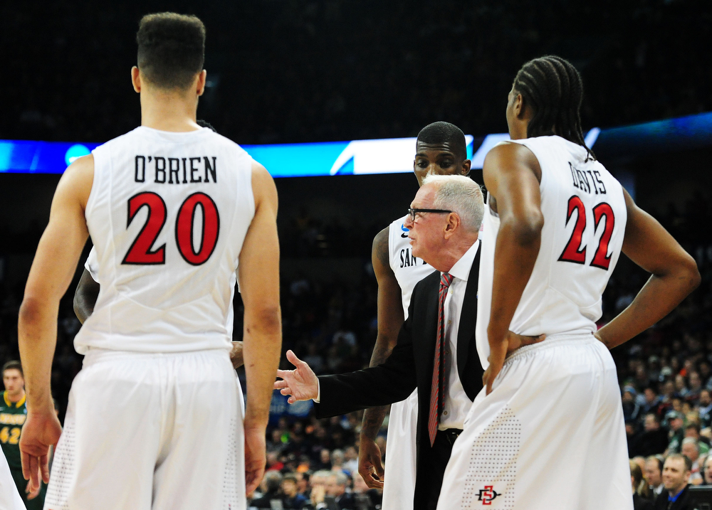 . Head coach Steve Fisher of the San Diego State Aztecs talks to his team in the first half against the North Dakota State Bison during the Third Round of the 2014 NCAA Basketball Tournament at Spokane Veterans Memorial Arena on March 22, 2014 in Spokane, Washington.  (Photo by Steve Dykes/Getty Images)