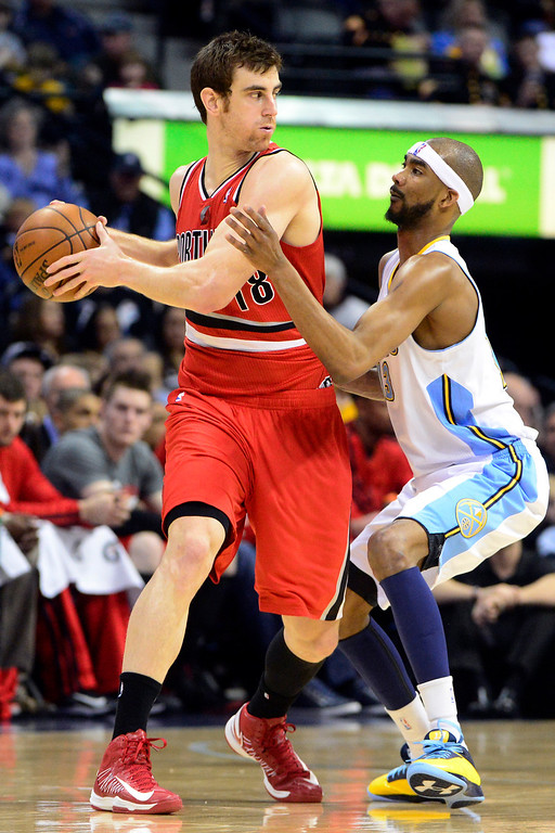 . DENVER, CO - APRIL 14: Victor Claver (18) of the Portland Trail Blazers looks for a teammate as Corey Brewer (13) of the Denver Nuggets defends during the first half of action. The Denver Nuggets play the Portland Trail Blazers at the Pepsi Center. (Photo by AAron Ontiveroz/The Denver Post)