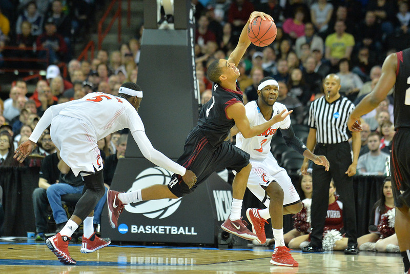 March 20, 2014: Harvard Crimson guard Siyani Chambers (1) is fouled during a second round game of the NCAA Division I Men's Basketball Championship between the 5-seed Cincinnati Bearcats and the 12-seed Harvard Crimson at Spokane Arena in Spokane, Wash. Harvard defeated Cincinnati 61-57.