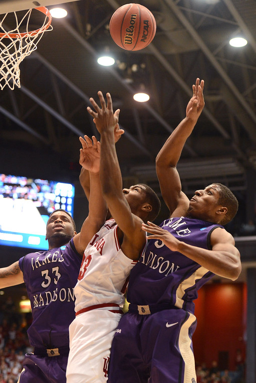 . DAYTON, OH - MARCH 22:  Remy Abell #23 of the Indiana Hoosiers drives with the ball against Rayshawn Goins #33 and Alioune Diouf #5 of the James Madison Dukes in the first half during the second round of the 2013 NCAA Men\'s Basketball Tournament at UD Arena on March 22, 2013 in Dayton, Ohio.  (Photo by Jason Miller/Getty Images)