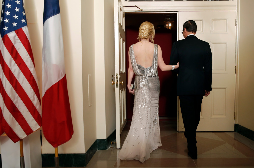 . Treasury Secretary Steve Mnuchin and his wife Louise Linton head into a State Dinner with French President Emmanuel Macron and President Donald Trump at the White House, Tuesday, April 24, 2018, in Washington. (AP Photo/Alex Brandon)