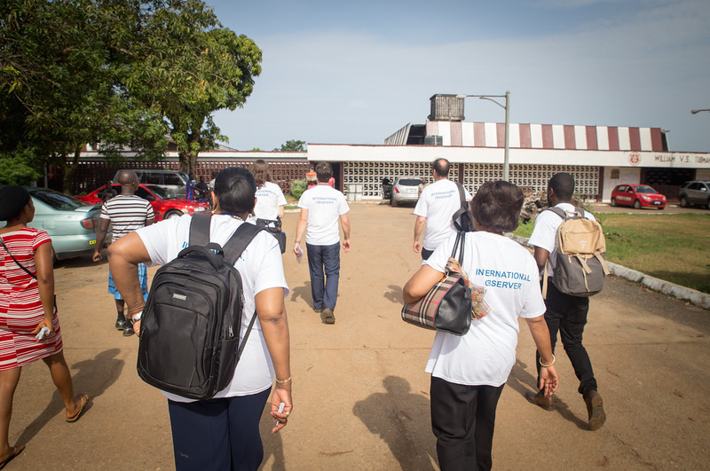 Monrovia, Liberia October 10, 2017 -  Carter Center election observers approach a polling station on election day.