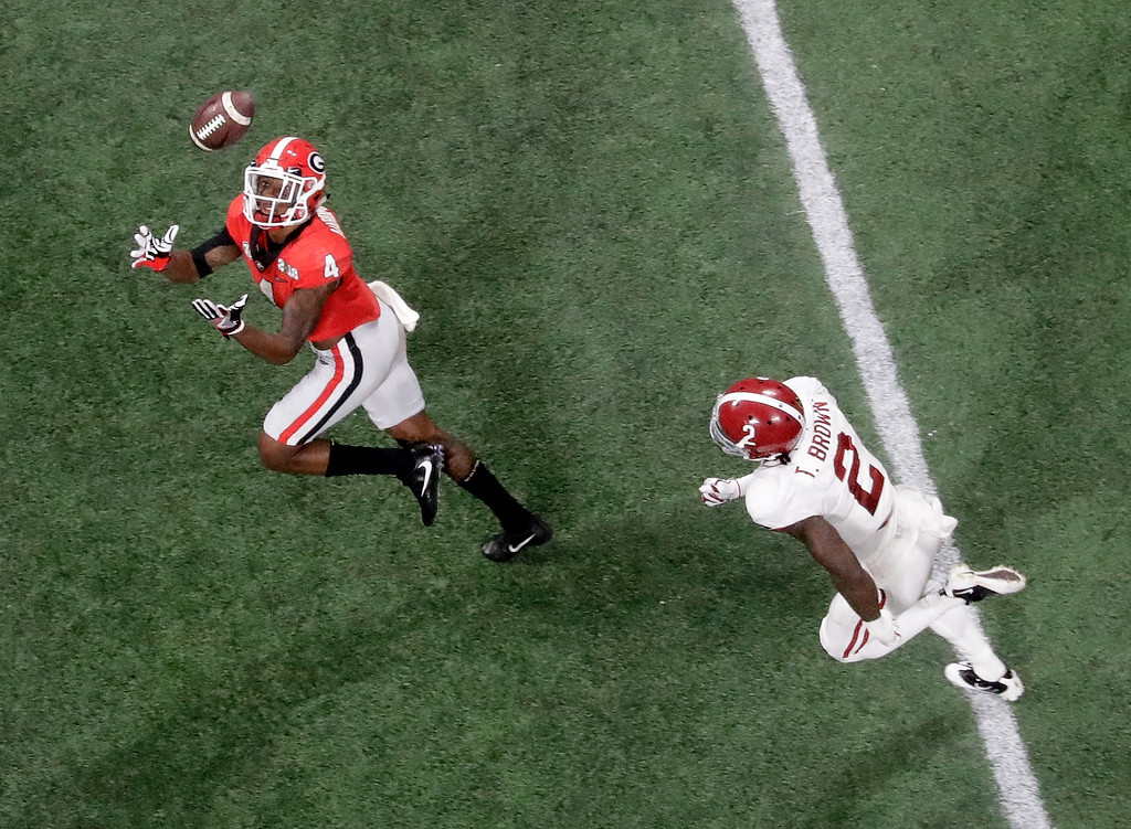 . Georgia wide receiver Mecole Hardman prepares to catch the ball ahead Alabama defensive back Tony Brown for a touchdown catch during the second half of the NCAA college football playoff championship game Monday, Jan. 8, 2018, in Atlanta. (AP Photo/John Bazemore)