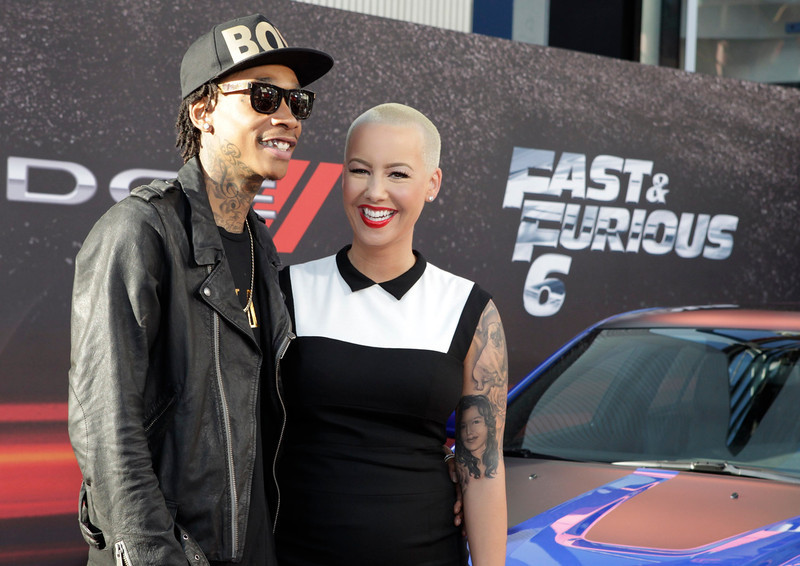 ". Rapper Wiz Khalifa and Amber Rose arrive as guests at the premiere of the new film, ""Fast & Furious 6\"" at Universal Citywalk in Los Angeles May 21, 2013. REUTERS/Fred Prouser"