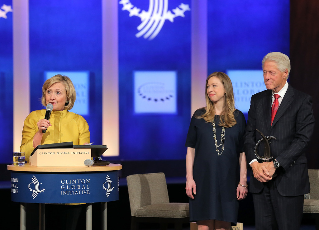 . (L-R) Former U.S. Secretary of State Hillary Clinton,  vice-chair of the Clinton Global Initiative Chelsea Clinton and founder of the Clinton Global Initiative Bill Clinton onstage during the fourth day of the Clinton Global Initiative\'s 10th Annual Meeting at the Sheraton New York Hotel & Towers on September 24, 2014 in New York City.   (Photo by Jemal Countess/Getty Images)