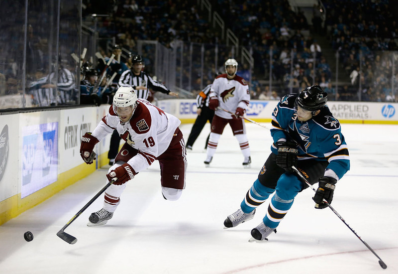 . SAN JOSE, CA - JANUARY 24:  Shane Doan #19 of the Phoenix Coyotes tries to skate around Douglas Murray #3 of the San Jose Sharks at HP Pavilion on January 24, 2013 in San Jose, California.  (Photo by Ezra Shaw/Getty Images)