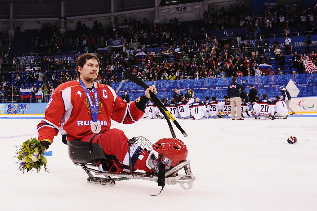 . Dmitrii Lisov of Russia celebrates after the ice sledge hockey gold medal game between the Russian Federation and the United States of America at the Shayba Arena during day eight of the 2014 Paralympic Winter Games on March 15, 2014 in Sochi, Russia.  (Photo by Dennis Grombkowski/Getty Images)