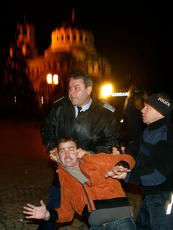 . Bulgarian police detain a man during a protest against high electricity prices, in front of the parliament in Sofia on February 18, 2013. Bulgaria\'s government sacked Finance Minister Simeon Djankov on Monday, dumping the man who has kept a tight rein on spending in the EU\'s poorest member amid nationwide protests over electricity prices. The sacking did little to soothe protesters\' anger and several thousand people gathered around the country to continue Bulgaria\'s biggest demonstrations since 1997, when a banking crisis and hyperinflation caused national unrest.  REUTERS/Stoyan Nenov