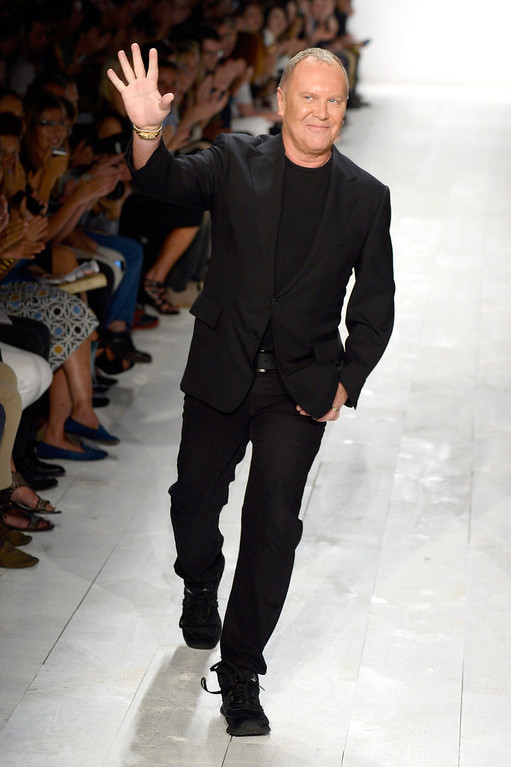 . Designer Michael Kors walks the runway at the Michael Kors fashion show during Mercedes-Benz Fashion Week Spring 2014 at The Theatre at Lincoln Center on September 11, 2013 in New York City.  (Photo by Frazer Harrison/Getty Images for Michael Kors)