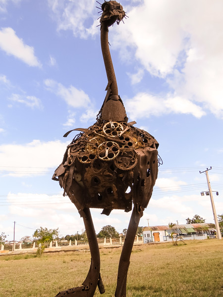 An ostrich sculpture of old bicycle change rings.