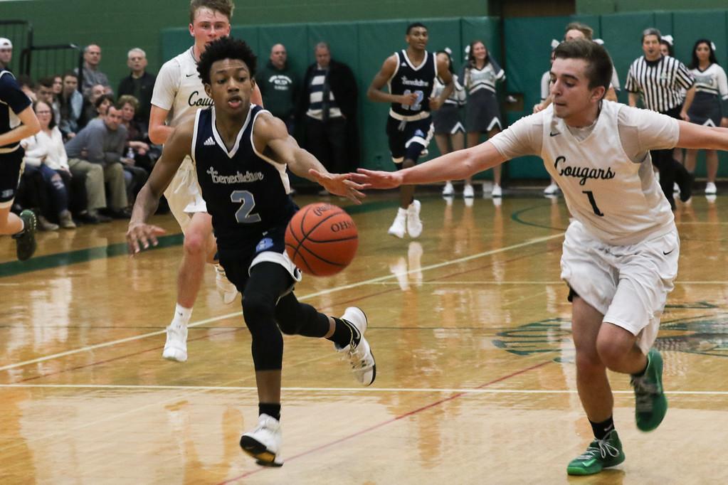 . 2018 - Basketball - Benedictine at Lake Catholic.  Benedictine defeated Lake Catholic 63-56.  Benedictine\'s Jashun Cobb (2) and Lake Catholic\'s Brandon Horton (1) chase a loose ball.