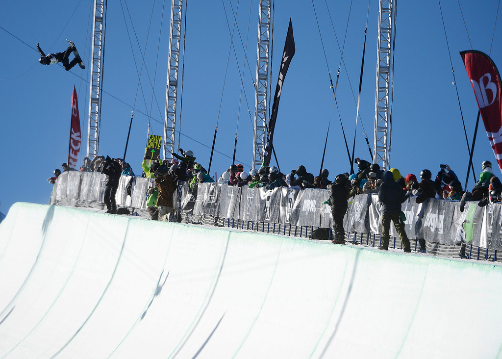 . Pro Snowboarder, Shaun White, launches on his first run of the Dew Tour Ion Mountain superpipe championship finals at Breckenridge Saturday afternoon, December 14, 2013. White crashed on this run and recovered on his second run to take second place with a score of 90.40. (Photo By Andy Cross/The Denver Post)