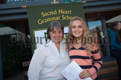 Sr Ann McGoldrick congratulates Niamh Owens who attained 12 A* grades. R1635019