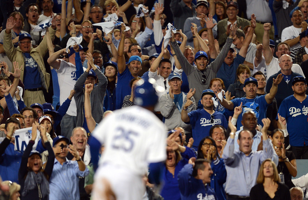 . Fans cheer as  Carl Crawford heads for  the dugout after scoring in the 8th inning during game 3 of the NLCS against the Cardinals at Dodger Stadium Monday, October 14, 2013. (Photo by Hans Gutknecht/Los Angeles Daily News)