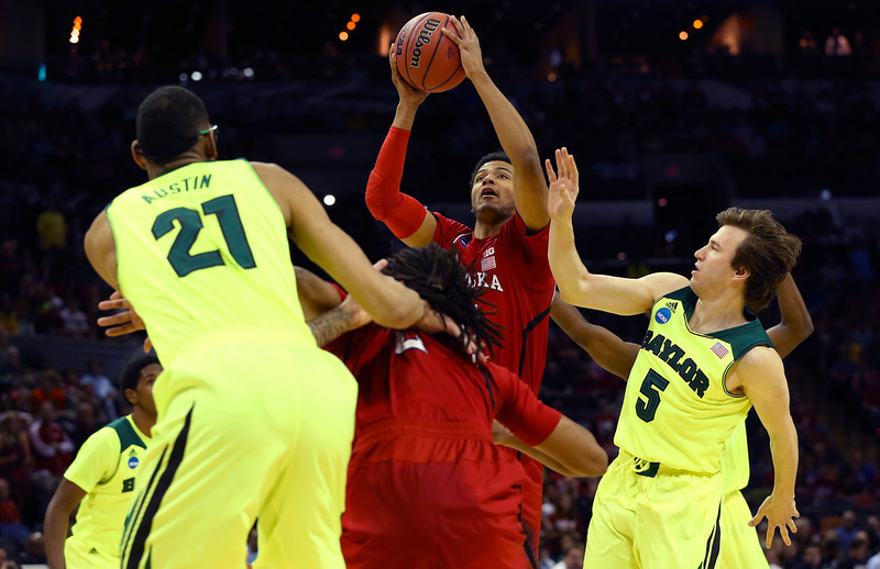 . Shavon Shields #31 of the Nebraska Cornhuskers goes up with the ball against Isaiah Austin #21 and Brady Heslip #5 of the Baylor Bears in the first half during the second round of the 2014 NCAA Men\'s Basketball Tournament at AT&T Center on March 21, 2014 in San Antonio, Texas.  (Photo by Ronald Martinez/Getty Images)