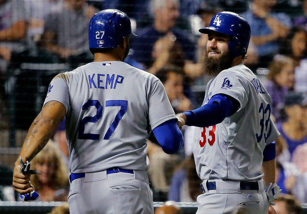 . Los Angeles Dodgers\' Matt Kemp (27) and Scott Van Slyke (33) celebrate after scoring on a Justin Turner two run double against the Colorado Rockies during the sixth inning of a baseball game Tuesday, Sept. 16, 2014, in Denver. (AP Photo/Jack Dempsey)
