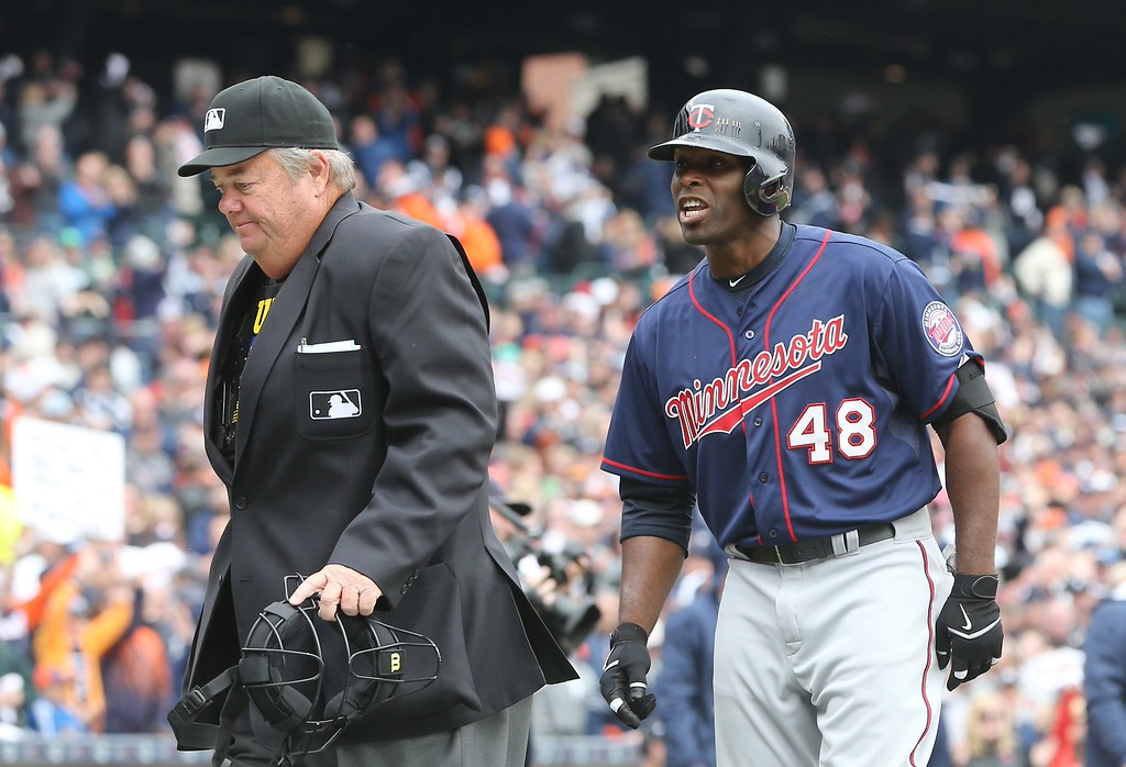 . Minnesota Twins\' Torii Hunter argues his strike three call with home plate umpire Joe West that ended the game in the ninth inning of an opening day baseball game against the Detroit Tigers in Detroit, Monday, April 6, 2015. The Tigers defeated the Twins 4-0. (AP Photo/Carlos Osorio)