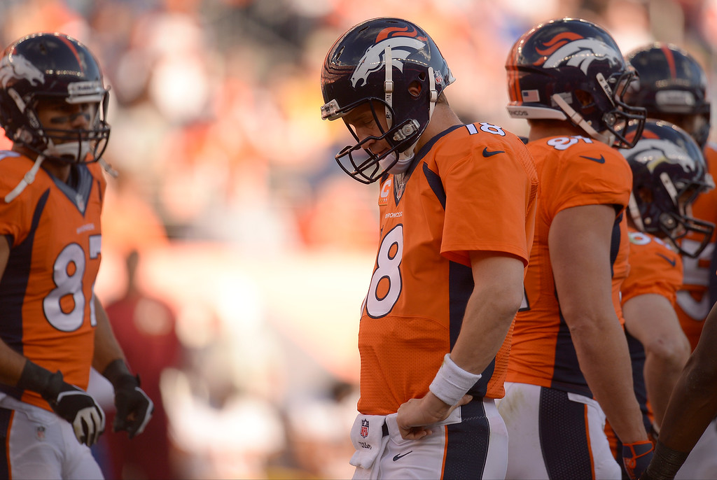 . Denver Broncos quarterback Peyton Manning (18) before a play in the third quarter against the Washington Redskins.  (Photo by John Leyba/The Denver Post)