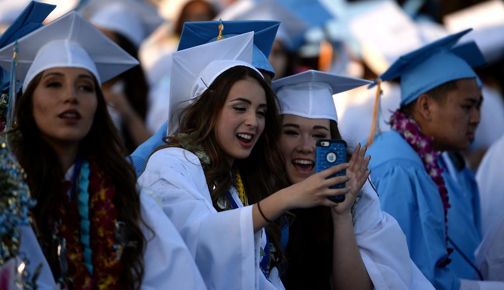 . Graduates take a selfie during the Walnut graduation in Ken Gunn Stadium at Walnut High School In Walnut, Calif., on Thursday, May 28, 2015.  (Photo by Keith Birmingham/ Pasadena Star-News)