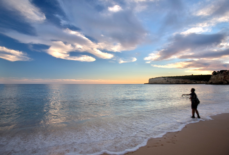 Man fishing on the beach, town of Porches, municipality of Lagoa, district of Faro, region of Algarve, Portugal