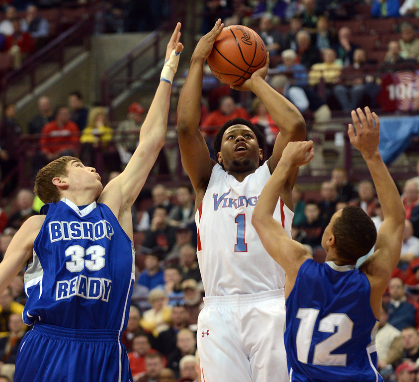 . Duncan Scott/DScott@News-Herald.com VASJ\'s Brian Parker goes up for a shot in the first quarter defended by Columbus Bishop Ready\'s Josh Gantz, left, and Shane Lee. VASJ won the Division III state semifinal on March 21, 55-40, to advance to the state final on March 22.