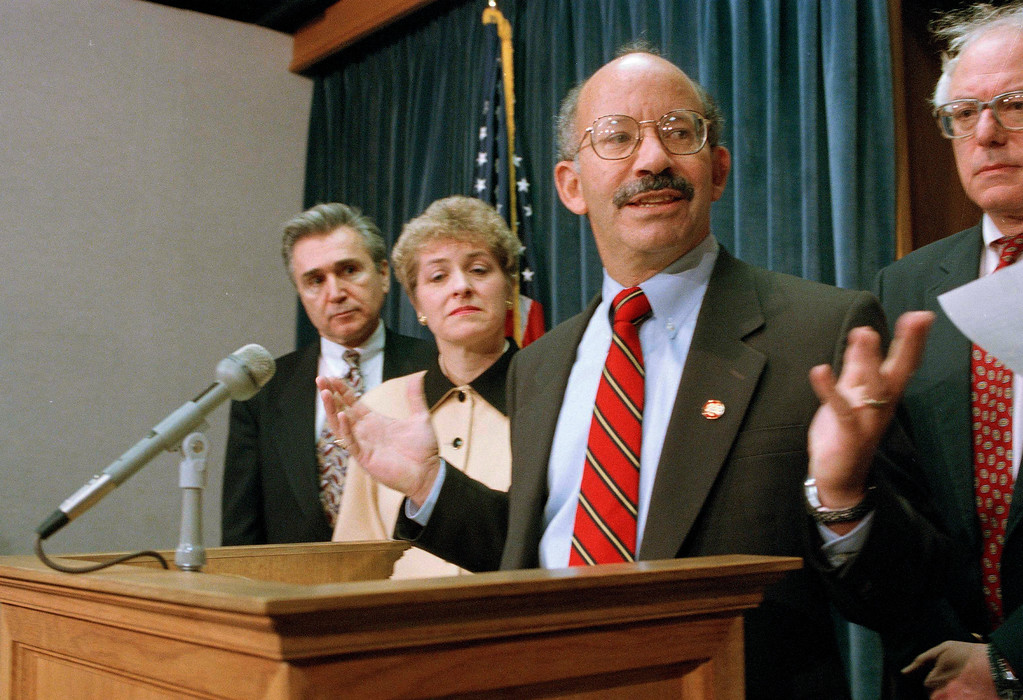 . Rep. Peter DeFazio (D-Ore.), center, accompanied by fellow House members, gestures during a news conference on Capitol Hill, Jan. 11, 1995, where they began a battle to remove the U.S. from the North American Free Trade Agreement (NAFTA). From left are: Reps. Maurice Hinchey (D-N.Y.), Marcy Kaptur (D-Ohio), DeFazio and Bernard Sanders (I-Vt.). (AP Photo/Joe Marquette)
