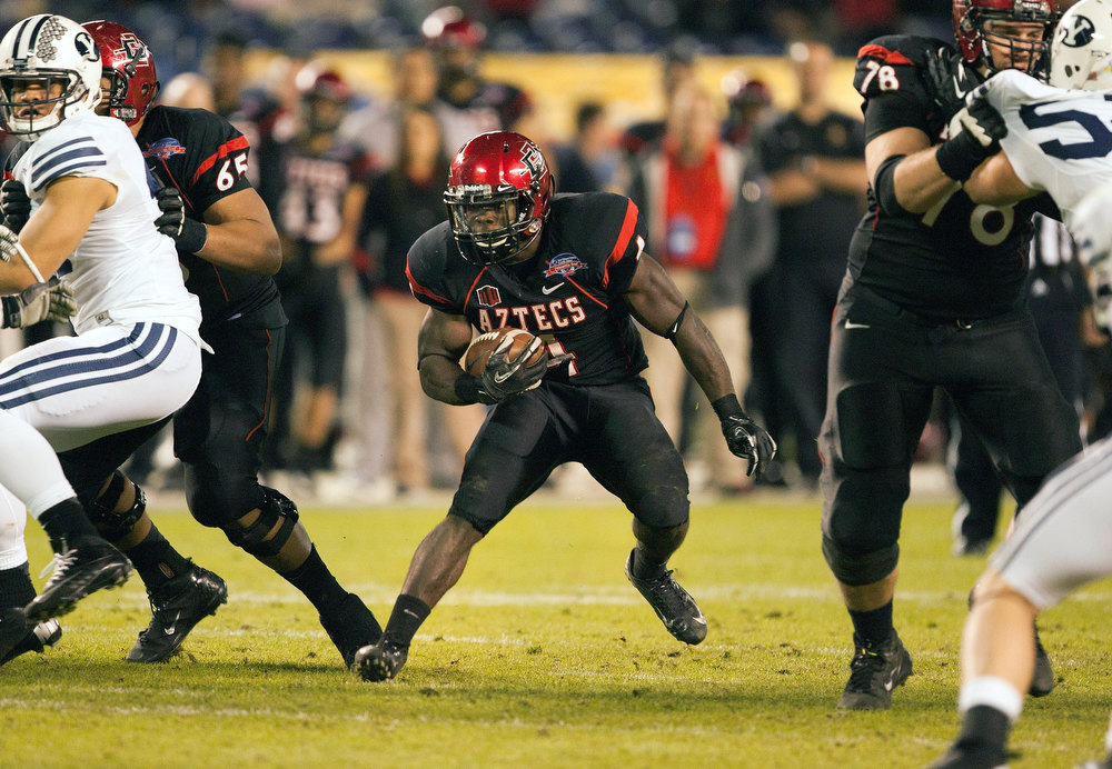 . Adam Muema #4 of the San Diego State Aztecs runs with the ball in the first half of the game against the BYU Cougars in the Poinsettia Bowl at Qualcomm Stadium on December 20, 2012 in San Diego, California. (Photo by Kent C. Horner/Getty Images)