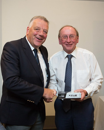 "John Mulqueen receiving ""Nearest The Pin"" Prize from Peter"