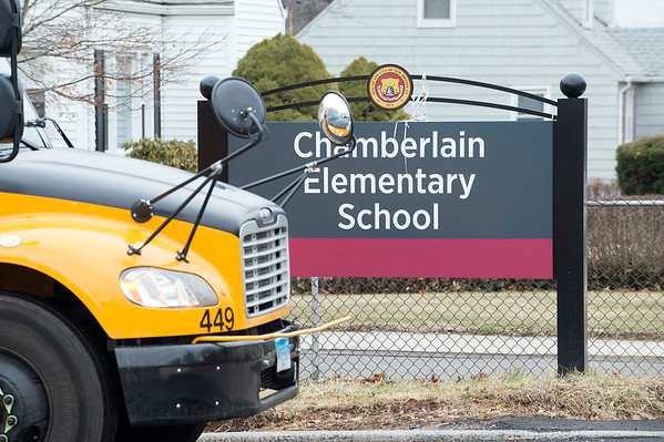 02/25/20 Wesley Bunnell | StaffrrA bus passes the main entrance to Chamberlain Elementary School on Feb 25, 2020 at the end of the school day.